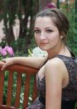 Mooie romantische meisjeszitting Stock Foto's