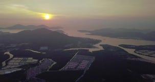 Mooie satellietbeeldzonsopgang van Lumut Maleisië vroege ochtend stock footage