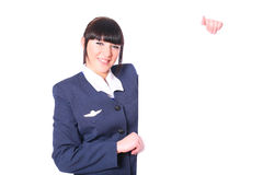 Mooie stewardess met een spatie Stock Foto's