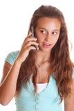 Mooie tiener op celtelefoon Stock Foto's