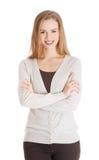 Mooie toevallige glimlachende vrouw met gekruiste handen. Royalty-vrije Stock Fotografie