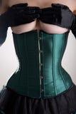 Mooie topless vrouw in groen korset Royalty-vrije Stock Afbeeldingen