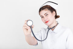 Mooie verpleegster met een stethoscoop Stock Foto