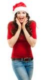 Mooie verraste vrouw die de hoed van de Kerstman dragen Royalty-vrije Stock Fotografie