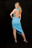 Mooie vrouw in blauwe kleding. royalty-vrije stock foto