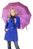 Mooie vrouw in blauwe laag met paraplu Royalty-vrije Stock Fotografie
