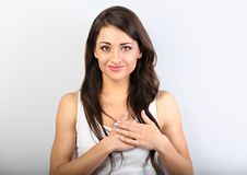 Mooie vrouw in borst en hart twee van de liefdeholding zelf hand royalty-vrije stock afbeelding