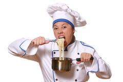 Mooie vrouw in chef-kokbeeld stock afbeelding