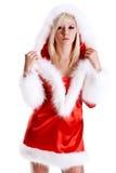 Mooie vrouw die de kleren van de Kerstman draagt stock afbeelding