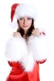 Mooie vrouw die de kleren van de Kerstman draagt Stock Fotografie