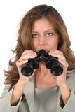Mooie Vrouw die door Verrekijkers 4 kijkt Stock Afbeeldingen