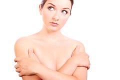 Mooie vrouw die haar borsten behandelt stock afbeelding