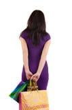 Mooie vrouw die met het winkelen zakken muur bekijkt. Royalty-vrije Stock Afbeelding