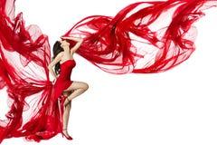 Mooie vrouw die in rode vliegende kleding danst Royalty-vrije Stock Afbeelding