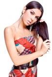 Mooie vrouw in een kleding Royalty-vrije Stock Afbeeldingen