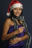 Mooie vrouw het drinken champagne in Kerstmis Royalty-vrije Stock Afbeeldingen
