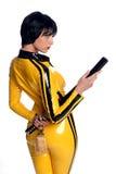 Mooie vrouw in het gele kostuum van de latexsprong Royalty-vrije Stock Afbeelding