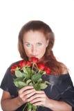 Mooie vrouw het snuiven rozen royalty-vrije stock fotografie