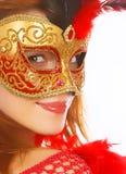 Mooie vrouw in masker Stock Foto