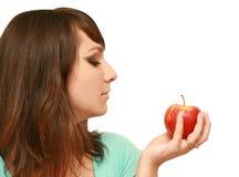 Mooie vrouw met appel Stock Afbeeldingen