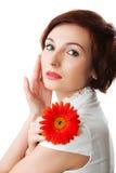 Mooie vrouw met bloem in haar handen Royalty-vrije Stock Fotografie