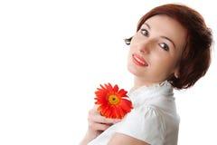 Mooie vrouw met bloem in haar handen Royalty-vrije Stock Foto