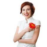 Mooie vrouw met bloem in haar handen Stock Foto's