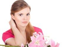 Mooie vrouw met bloemen Stock Fotografie