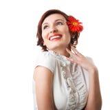 Mooie vrouw met bloemgerbera Stock Afbeelding