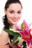 Mooie vrouw met bos van bloemen Royalty-vrije Stock Fotografie