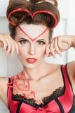 Mooie vrouw met de make-up van de valentijnskaartendag Stock Afbeelding