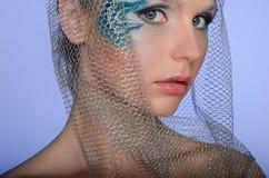 Mooie vrouw met de meermin van de gezichtskunst Stock Fotografie