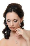 Mooie vrouw met dure juwelen Stock Foto