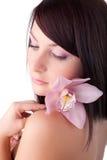Mooie vrouw met een bloem stock afbeeldingen