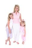 Mooie Vrouw met Haar Dochters over Wit Stock Afbeeldingen