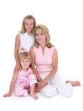 Mooie Vrouw met Haar Dochters over Wit Stock Afbeelding
