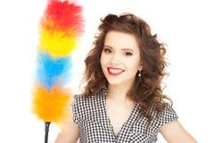 Mooie vrouw met het schoonmaken van bereik Royalty-vrije Stock Fotografie
