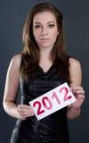Mooie vrouw met het teken van 2012 Stock Foto