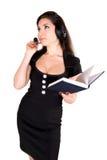 Mooie vrouw met hoofdtelefoon en notitieboekje Royalty-vrije Stock Fotografie