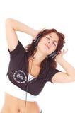 Mooie vrouw met hoofdtelefoons Stock Afbeelding