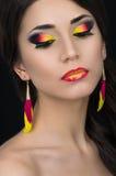 Mooie vrouw met kleurrijke samenstelling royalty-vrije stock afbeeldingen