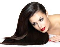 Mooie vrouw met lange bruine rechte haren Royalty-vrije Stock Foto