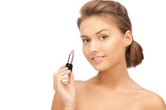 Mooie vrouw met lippenstift stock fotografie