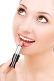 Mooie vrouw met lippenstift royalty-vrije stock afbeelding