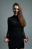 Mooie vrouw met make-upskelet Stock Fotografie