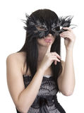Mooie vrouw met masker en vinger dichtbij lippen Royalty-vrije Stock Afbeeldingen
