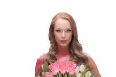 Mooie vrouw met tulpen stock afbeeldingen