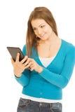 Mooie vrouw met tablet Stock Foto