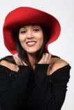 Mooie Vrouw in Red Hat Stock Afbeelding
