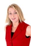 Mooie Vrouw in Rood Sleeveless Pak Stock Afbeelding